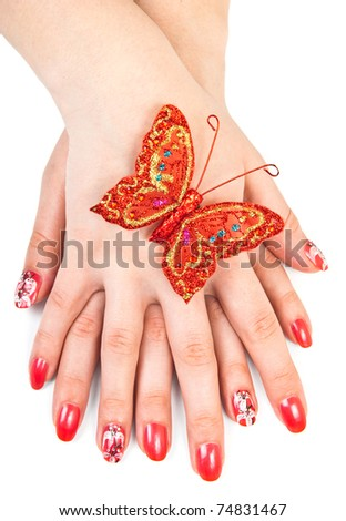 Woman hands with red manicure over white