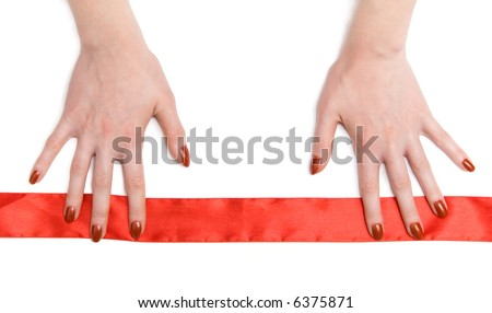 Woman hands with red ribbon. On white.