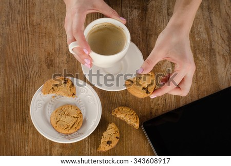Woman hands with tablet computer and Breakfast. View from above