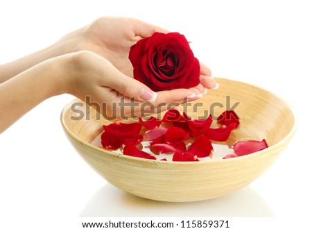 woman hands with wooden bowl of water with petals, isolated on white