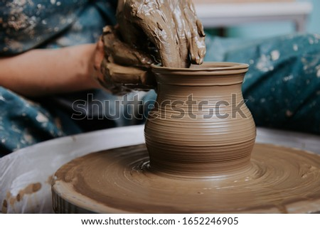 Woman hands working on pottery wheel and making a pot. Сток-фото ©