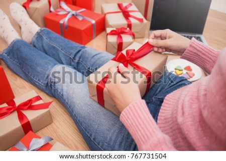 Woman hands wrapping gift box top view, celebration holiday christmas unwrap open box concept.