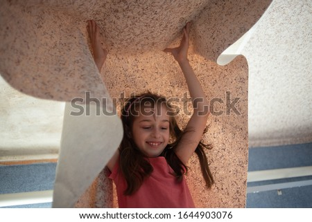 Woman hanging wallpaper motif. Teen girl helps to glue wallpaper on the ceiling. A girl of 9 years helps parents make repairs in the room. Help child. Teenager Stockfoto ©