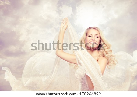 Woman Happy, beautiful blonde carefree dancing with flying fabric