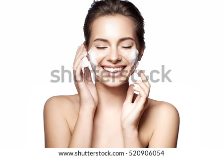 woman happy cleanses the skin...