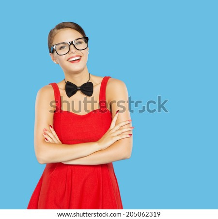 Woman happy in funny vintage glasses and bow tie. Blue Background
