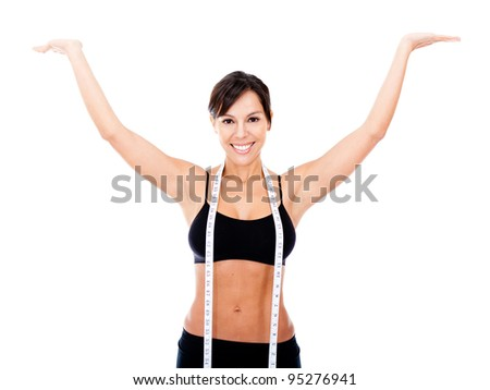 Woman happy with her weight loss - isolated over a white background