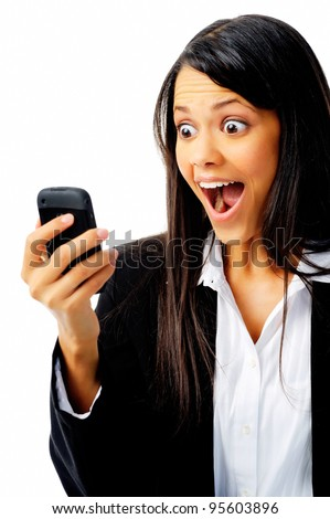 woman has a reaction of surprise as she reads a message on her mobile phone, isolated on white.