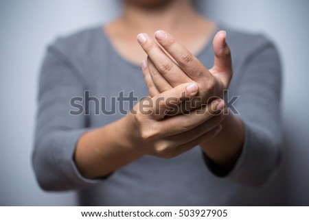 Woman has hand pain - Shutterstock ID 503927905