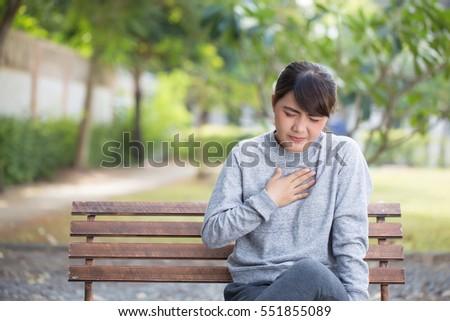 Shutterstock Woman has reflux acids at park