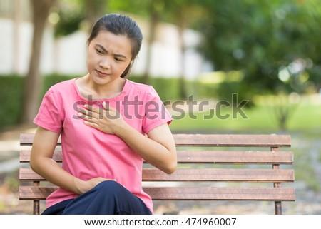 Shutterstock Woman has reflux acids in the garden