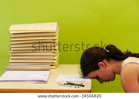 woman has stress because of huge work on her desk - stock photo