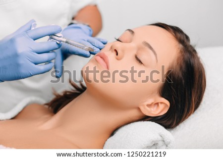 woman have facial injections for skin rejuvenation #1250221219
