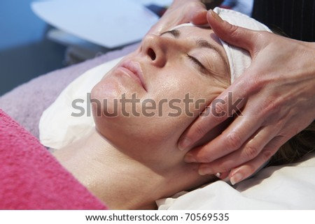 woman having a facial treatment in beauty salon