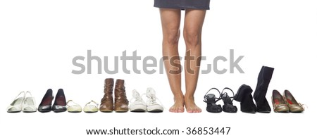 Woman having a hard time choosing what shoes to wear.
