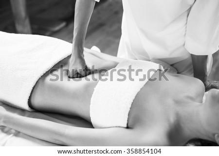 Woman having abdomen massage. #358854104
