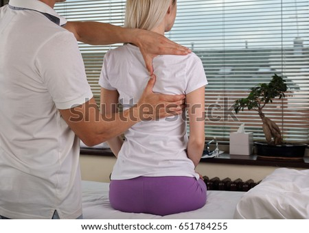 Woman having chiropractic back adjustment, healing treatment. Osteopathy, manual therapy, acupressure. Alternative medicine, pain relief concept. Rehabilitation after sport Injury, Physical therapy.