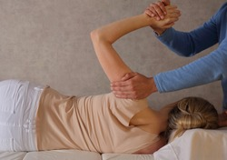 Woman having Chiropractic Back Adjustment / Physiotherapy Treatment . Scoliosis Posture Correction for Female Patient .