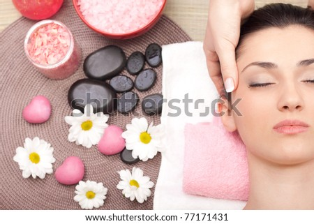 woman having cosmetic massage, close up