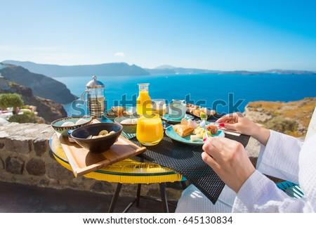 Woman having delicious breakfast in Mediterranean summer #645130834