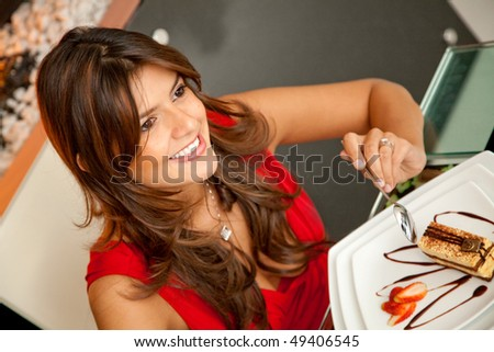 Woman having dinner at a romantic restaurant