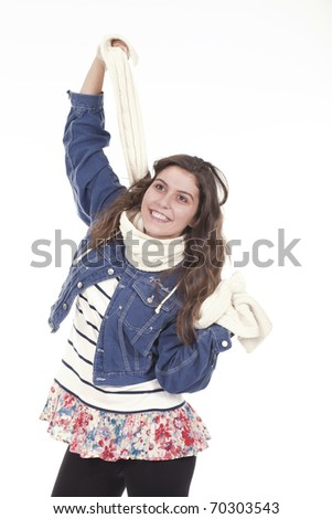 woman having fun and playing with her scarf