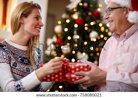 Woman having gift surprise from parent for Christmas
