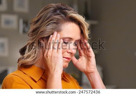 Woman having headache migraine. Stress and depression. Foto stock ©