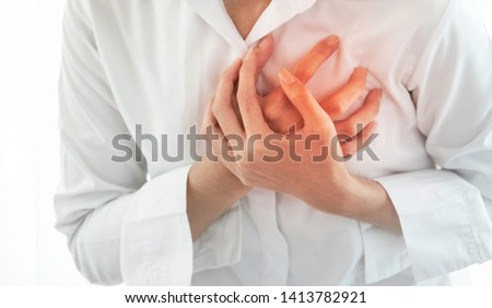 Woman having heart attack .Healthcare and medical concept.