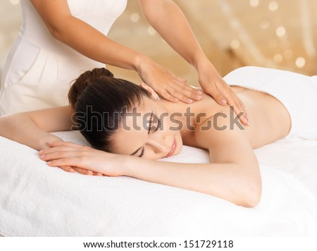 Woman having massage of body in the spa salon beauty treatment concept stock photo 151729118 - Salon massage body body paris ...