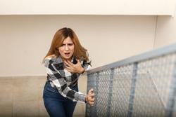 Woman having panic attack while walking upstairs