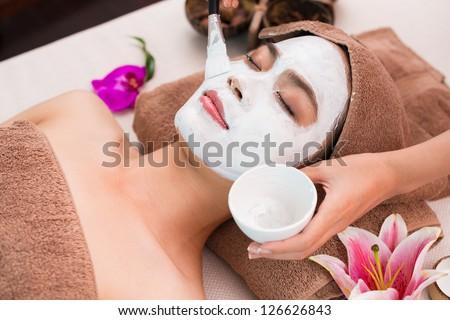 Woman having peeling in spa salon - stock photo