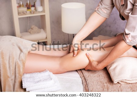 Woman having  rejuvenating foot massage for athletes, in Spa Salon