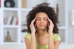 woman headache or anxiety attack crisis