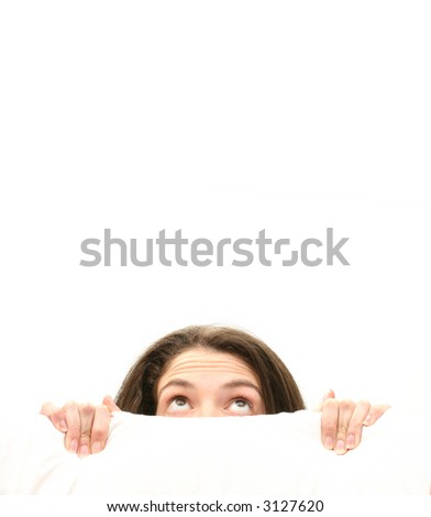 woman hiding behind a white screen