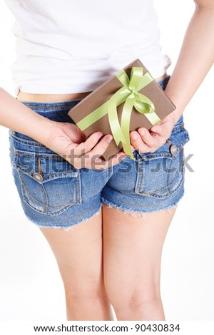 woman hiding gift box and ready to surprise