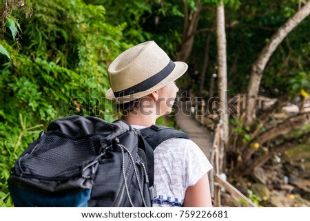 woman hiker in hike with a big backpack back view #759226681