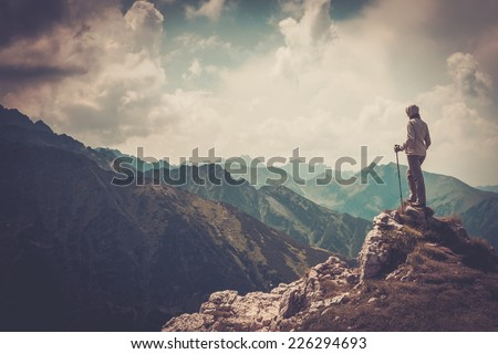 woman hiker on a top of a...