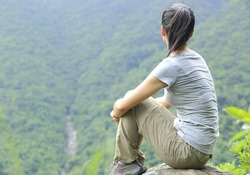 woman hiker sit mountain top