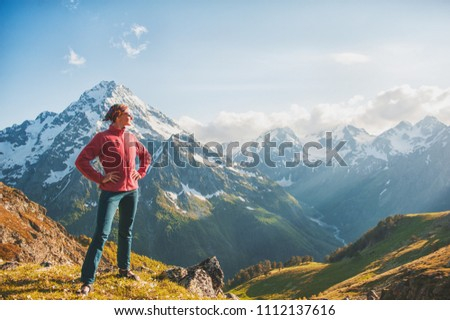 Woman hiker standing on the top of mountain outdoor #1112137616
