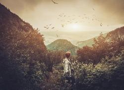 Woman hiker walking in a mountain forest
