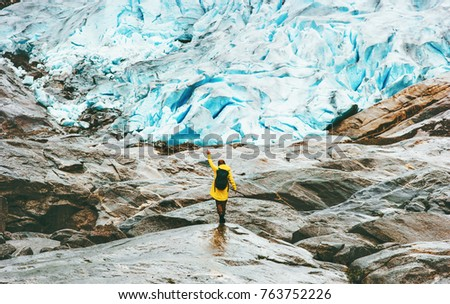 Woman hiking at Nigardsbreen glacier  Travel Lifestyle ecology concept adventure vacations outdoor nature in Norway #763752226