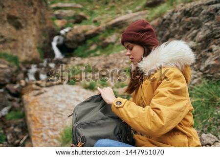 woman hiking backpack hiking mountain #1447951070