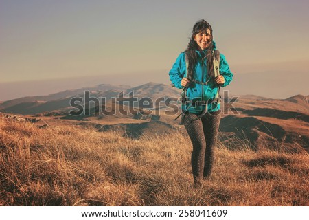 Woman hiking in beautiful nature, recreation and healthy lifestyle outdoors in wild. Hiker backpacker walking on mountain top.