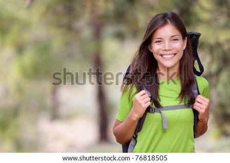 Woman hiking portrait with copy space. Fresh and healthy female model during hike outdoors in forest. Beautiful mixed race Caucasian / Chinese Asian young woman. Teide, Tenerife, Canary Islands, Spain
