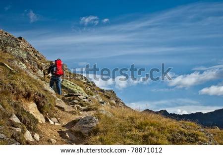 woman hiking with babycarrier and baby boy in hannig range, swiss