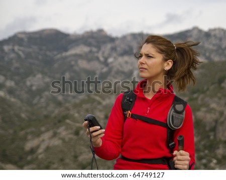 woman hiking with GPS