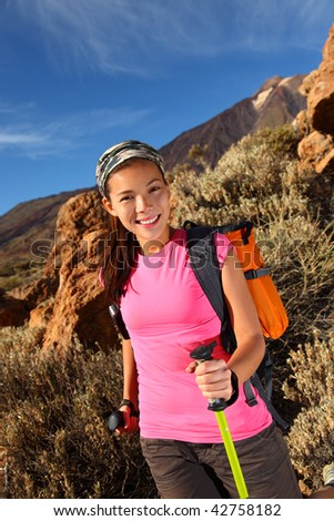 Woman hiking. Young asian female model hiking / backpacking in beautiful volcanic landscape on the volcano, Teide, Tenerife, Spain.