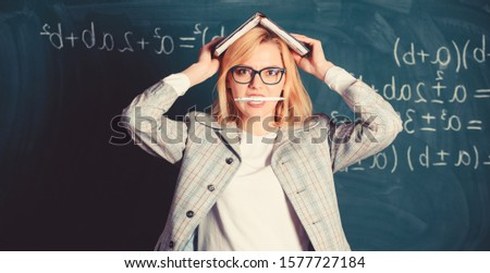 Woman hold book bite pen chalkboard background. Inspired work harder. Inspiration or creativity crisis concept. Learn be inspiring teacher. Inspiring teacher spark motivation. Looking for inspiration.