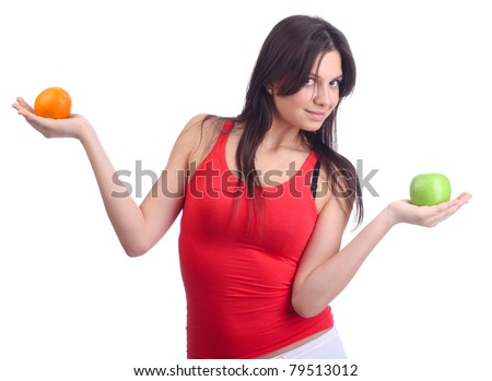 Woman hold fruit - apple and orange
